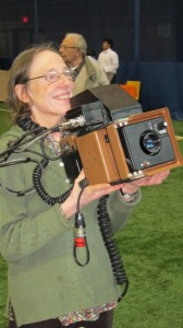 Laura showing old SLR id camera