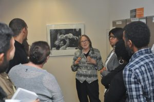 Laura giving tour of her photos at the Ontario Human Rights Commission