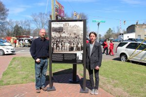 Morgan Phillips and his son Zenon Phillips standing by John F Phillips photo of Selma march in 1965