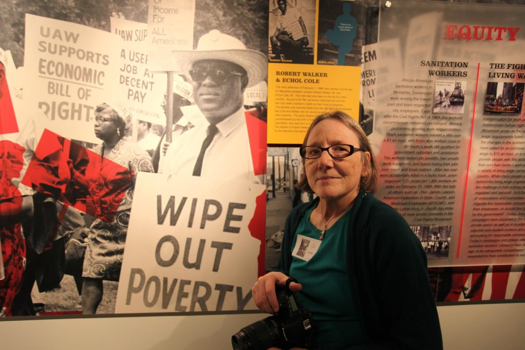 Laura Jones with one of her anti-poverty photographs